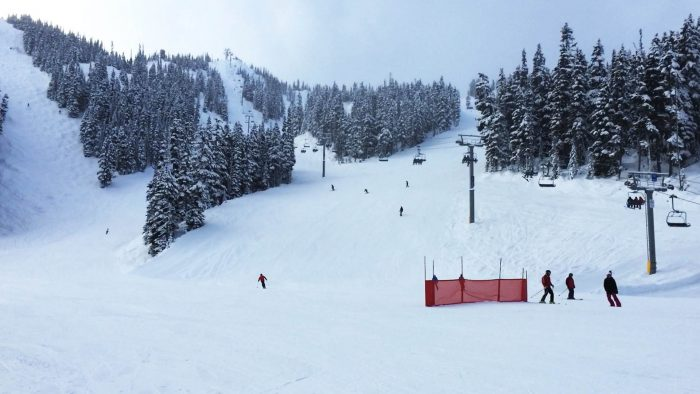 Timelapse of skiiers and snowboarders on Blackcomb mountain.